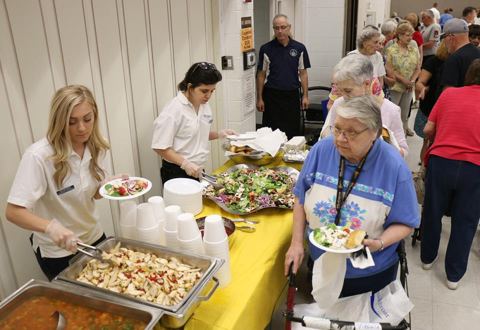 Volunteers Serve Seniors Lunch